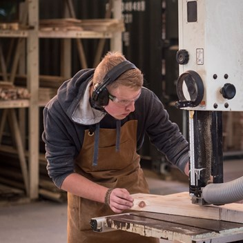 Plankbridge hutmaker at work on the bandsaw cutting timber