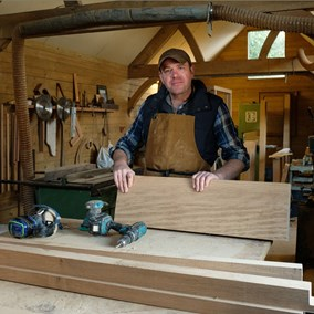 English oak windows by David Higgs, who is standing in his workshop