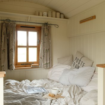 Snug shepherd's hut bed