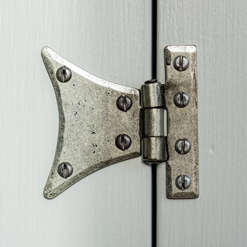 Plankbridge wrought iron pewter finish hinge on a painted door