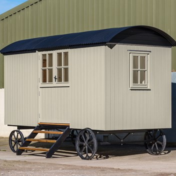 Timber clad shepherd's hut with double doors painted all in Pigeon
