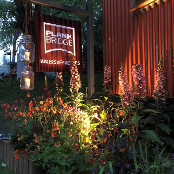 RHS Chelsea Flower show shepherds hut by night