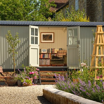 Plankbridge shepherd's hut cabin in garden