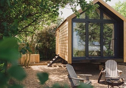 Damson, a glazed end glamping hut at Elmley on The Isle of Sheppey