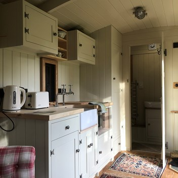 Micro kitchen interior in a Cabin hut, with Belfast sink and small oven