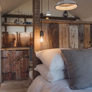 Elmley Saltbox, reclaimed timber headboard and kitchen